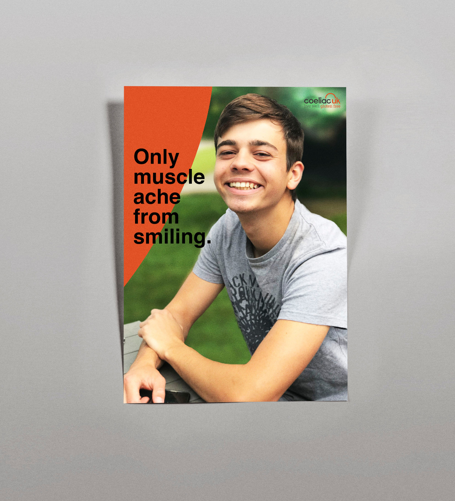 """Only muscle ache from smiling"". A poster that expresses the happiness felt by someone after being diagnosed with Coeliac disease, as they begin to feel better again."