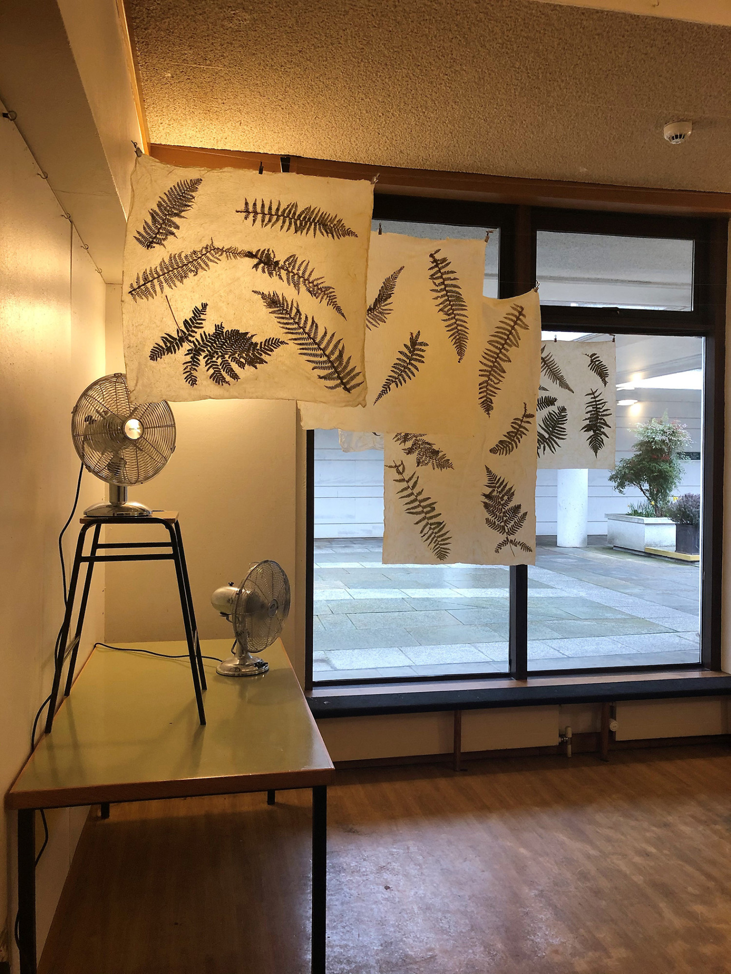 """Contingent on Carbon"", 2019, Installation – Latex, fern fronds, lab stools, desk fans - Sarah Strachan"